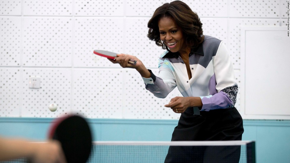 Obama plays table tennis on Friday, March 21, as she visits the Beijing Normal School, which prepares students to attend college abroad.