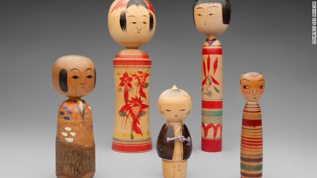 Kokeshi dolls are characterized by lack of arms and legs and  brightly painted floral or geometric designs.