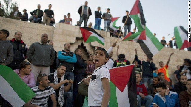 A young  Palestinian boy shouts as he takes part in a protest at Jerusalem's Damascus Gate against the killing of three Palestinians at Jenin refugee camp.