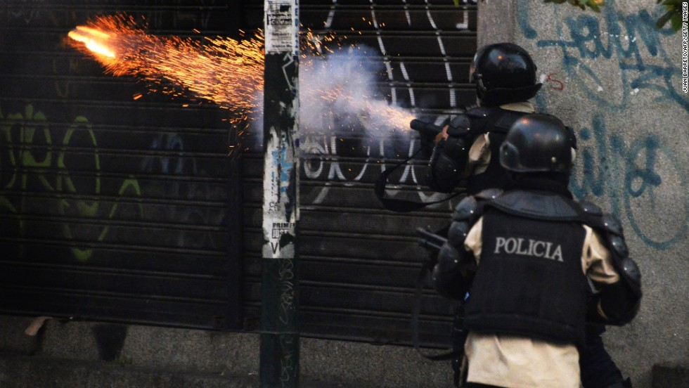Riot police shoot tear gas during the March 22 protest.