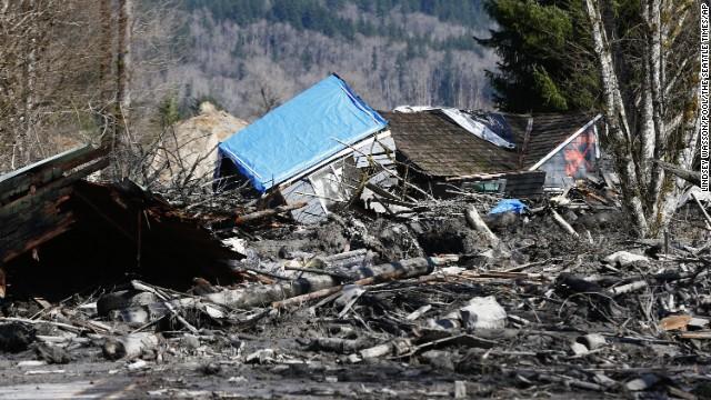 Desperate search for landslide survivors
