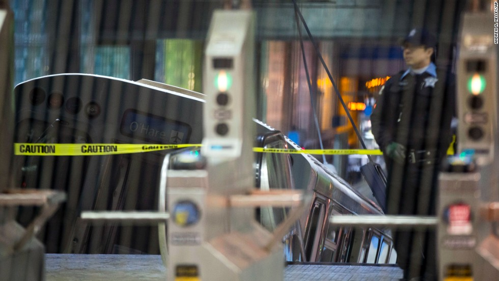 A police officer stands near the derailed train. The Chicago Transit Authority's Blue Line service was suspended between the O'Hare airport and the Rosemont stop after the derailment, a CNN affiliate reported.