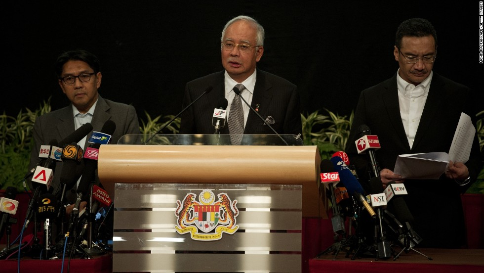 "Malaysian Prime Minister Najib Razak, center, delivers a statement about the flight on March 24, 2014. Razak's announcement came after the airline sent a text message to relatives saying it ""deeply regrets that we have to assume beyond any reasonable doubt that MH 370 has been lost and that none of those onboard survived."""