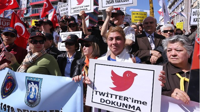 "Protesters in Ankara hold ""Do not touch my Twitter"" placards during a demonstration last month against Turkey's Twitter ban."