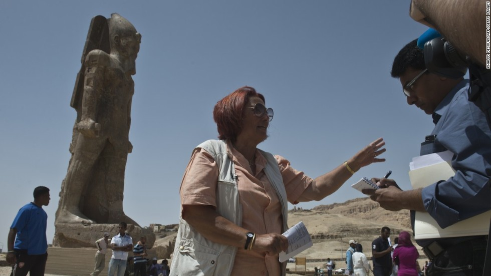 German archaeologist Hourig Sourouzian, who heads the project to conserve the Amenhotep III temple, speaks to media in front of one of the two newly displayed statues. The statues were restored after being discovered in pieces during excavations at the site.