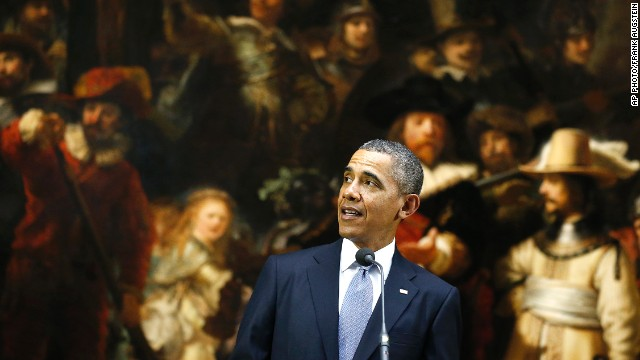 U.S. President Barack Obama stands in front of Dutch master Rembrandt's The Night Watch painting during a visit to Europe.
