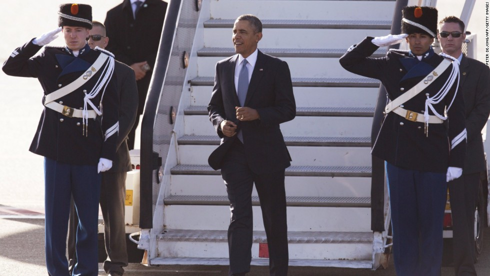 Obama disembarks from Air Force One after arriving in Amsterdam, Netherlands, on Monday, March 24.