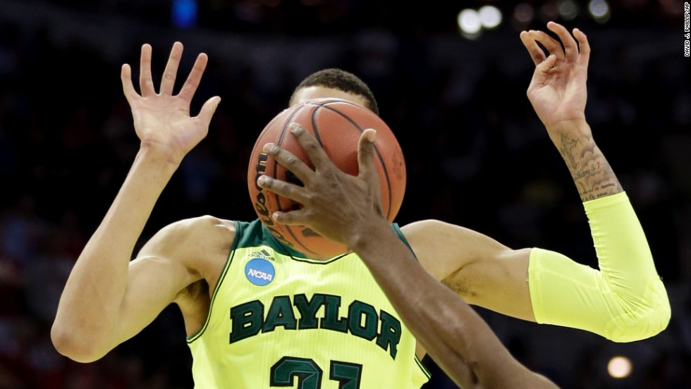 The face of Baylor's Isaiah Austin is covered by the basketball in this photo from the NCAA Tournament on Friday, March 21.