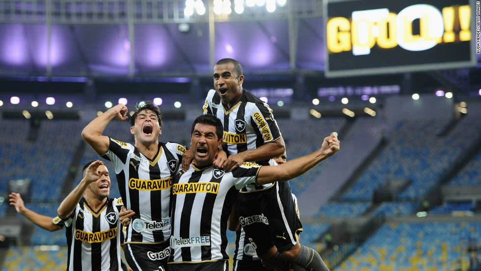 Players from Botafogo celebrate a goal against Independiente del Valle on Tuesday, March 18, during their Copa Libertadores soccer match in Rio de Janeiro.