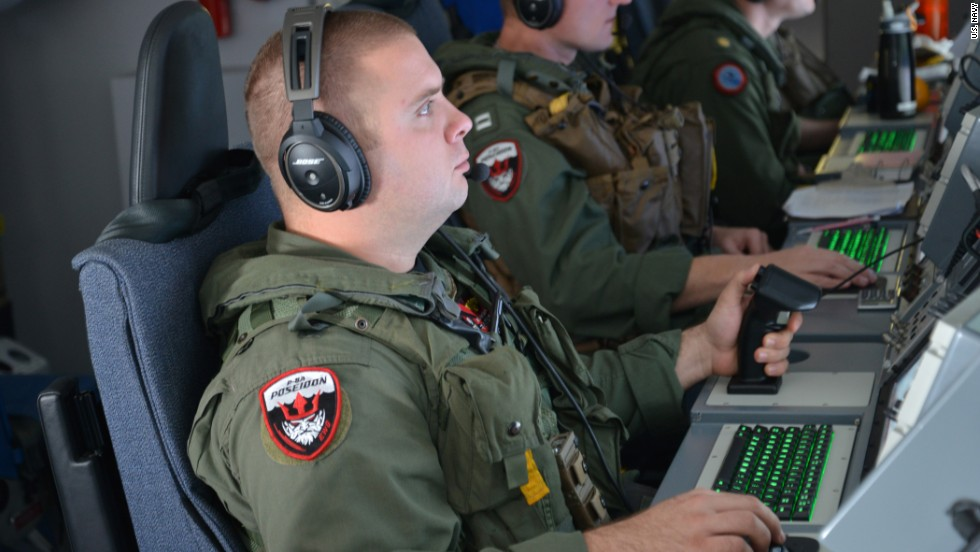 A U.S. airman monitors his instruments aboard a P-8 Poseidon during a mission in the southern Indian Ocean on March 23.
