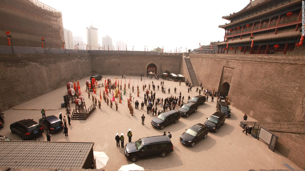 Obama's family and her entourage visit the ancient walled city in Xian, China, on Monday, March 24.
