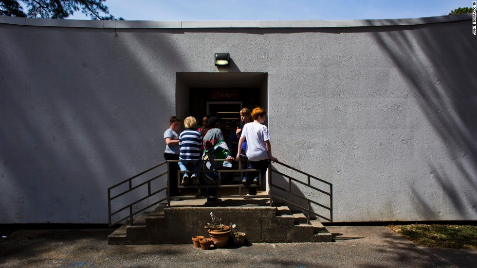 Students wait to go back inside from the playground at Hess Academy.