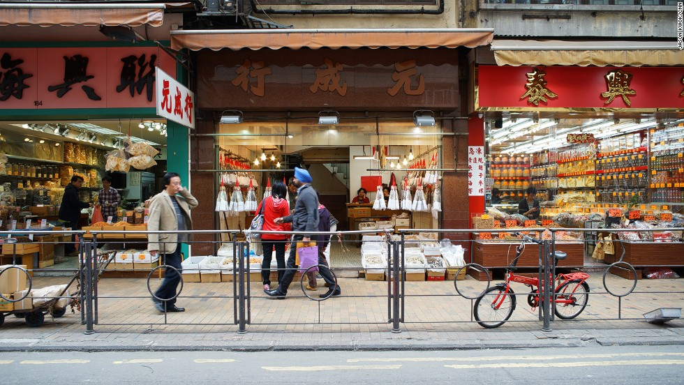 "The tram runs along Des Vouex Road West in Sheung Wan -- also known as ""Dried Seafood Street."" Eric Lee Tsun-lung, founder of tram fan club <a href=""http://www.mytramways.com"" target=""_blank"">Hong Kong Trams Enthusiast</a>, says the best time to visit is late morning or early afternoon, when vendors are busy laying out goods to dry in the sun."