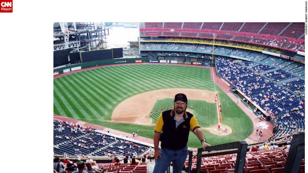 <strong>Cinergy Field (2002):</strong> Ondrovic poses for a photo in the stands at the home of baseball's first professional franchise, the Cincinnati Reds. The team played there from 1970 to 2002, when it was demolished. The team now plays at Great American Ballpark.