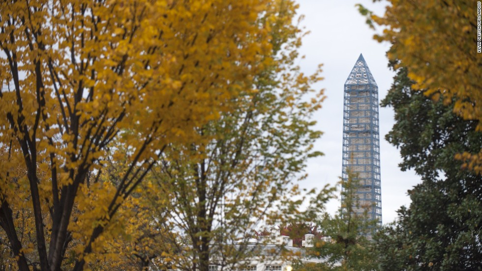 The Washington Monument is framed by fall foliage in November.