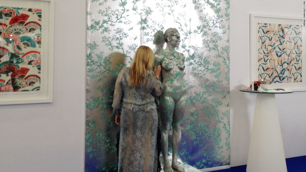 "In a Hong Kong Affordable Art live exhibit, Australian artist Emma Hack painted a nearly nude woman to blend in with the wallpaper. Hack is known internationally for her gorgeous body illustrations. Most famously, she painted Australian pop singer Gotye and New Zealander Kimbra for the music video that accompanied hit song ""Somebody That I Used to Know."""