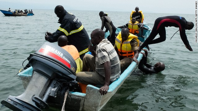 Uganda Police divers and local fishermen search for victims of a boat disaster on Lake Albert near Kitebere on March 23, 2013.