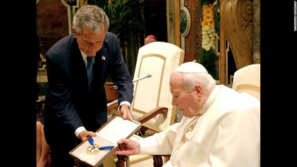 President George W. Bush presents Pope John Paul II with the Presidential Medal of Freedom at the Vatican in 2004. During their meeting, the Pope reminded Bush of the Vatican's strong opposition to the U.S.-led invasion of Iraq.