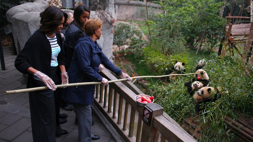 First lady Michelle Obama and her mother, Marian Robinson, feed apples to giant pandas at the Giant Panda Research Base in Chengdu, China, on Wednesday, March 26. Click through to see more highlights of the first lady's trip to China.