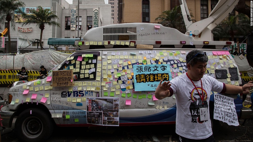 Anti-media slogans are posted on a TV station's van during a rally outside the Legislature on Monday, March 24.