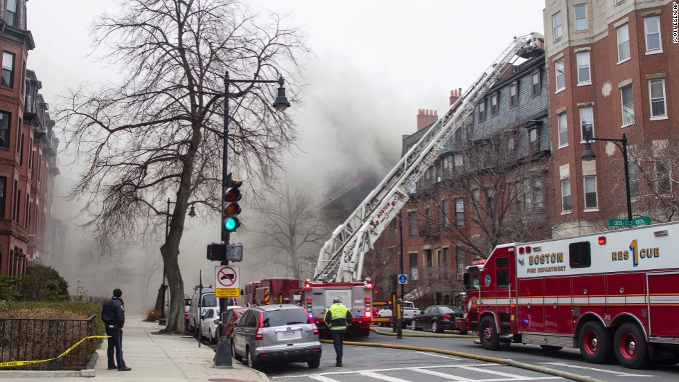 Firefighters work to extinguish the blaze, which began in the basement of a four-story brick brownstone, the Boston Fire Department said on its Twitter account.