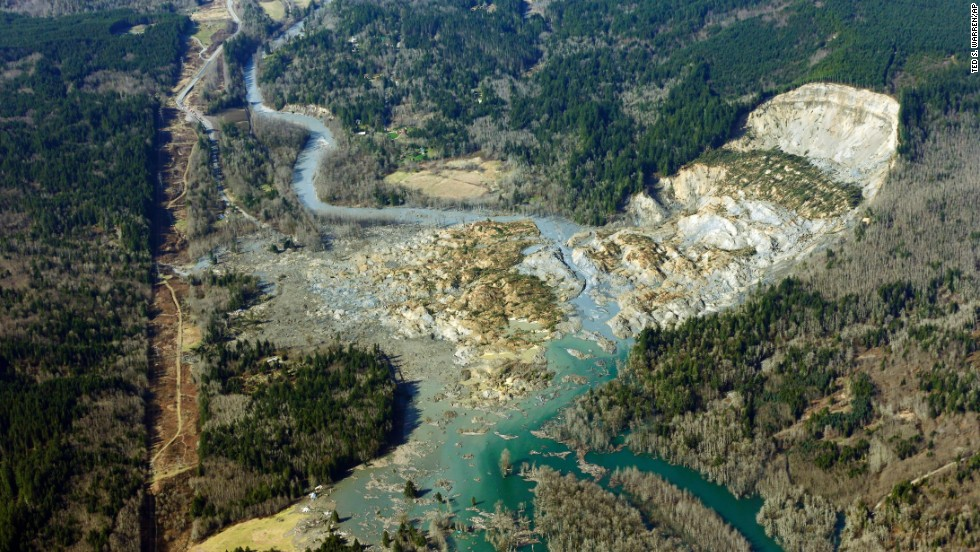 The remains of the massive landslide are seen on Monday, March 24. The landslide blocked the highway and the Stillaguamish River.
