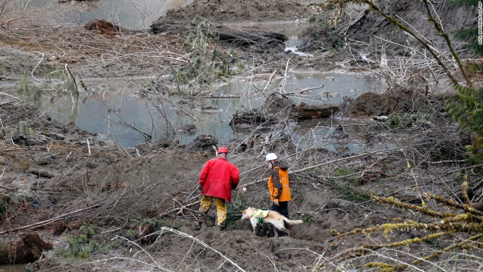 Search-and-rescue workers look through debris on March 26.
