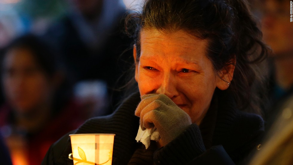 "Teresa Welter cries during a candlelight vigil held Tuesday, March 25, for landslide victims in Snohomish County, Washington. <a href=""http://www.cnn.com/2014/03/22/us/gallery/washington-landslide/index.html"">The deadly landslide</a> left buildings covered in up to 40 feet of mud, and dozens of people remain unaccounted for."
