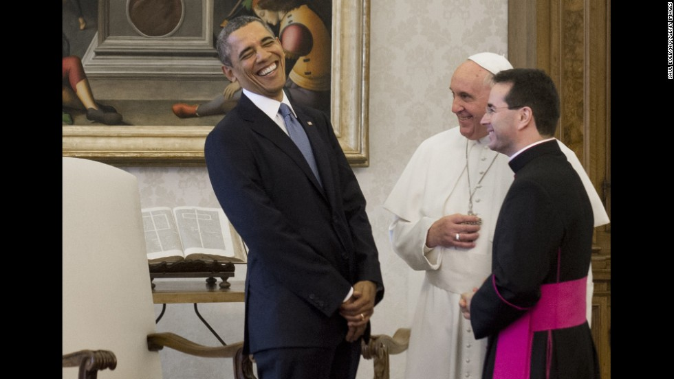 Francis speaks with U.S. President Barack Obama, who visited the Vatican in March 2014.