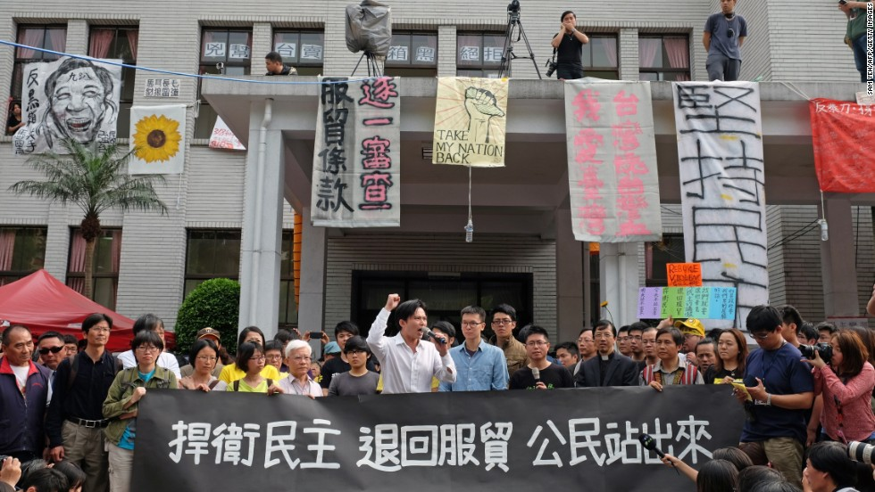 Protesters who oppose the trade agreement hold a rally outside Taiwan's Legislature on Thursday, March 27.