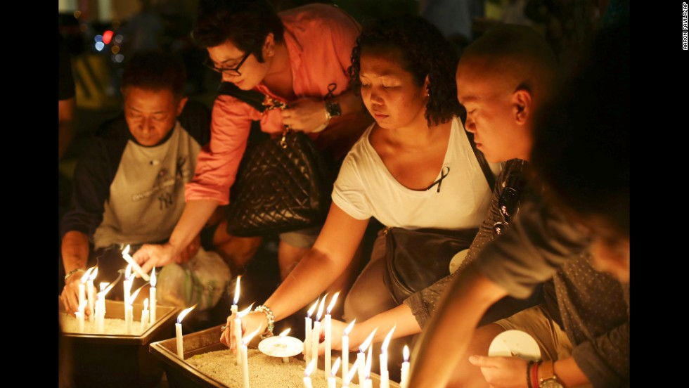 People in Kuala Lumpur light candles during a ceremony held for the missing flight's passengers on March 27, 2014.