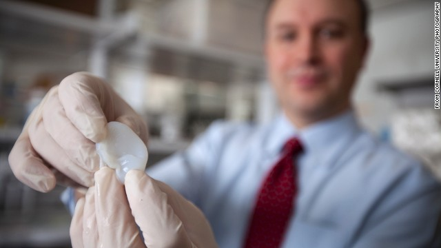Lawrence Bonassar, a professor of biomedical engineering at Cornell University, with an artificial ear made via 3-D printing and injectable molds.