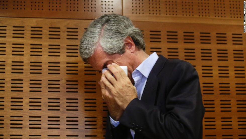 Adolfo Suarez Illana, son of former Spanish Prime Minister Adolfo Suarez, cries after announcing the imminent death of his father Friday, March 21, in Madrid.