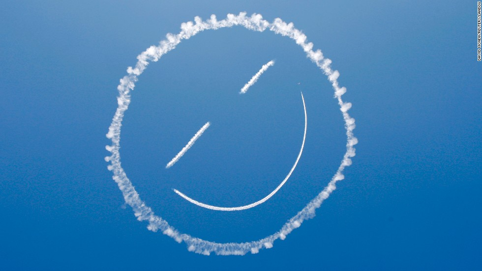 A skywriter draws a smiley face at the start of the Los Angeles County Air Show that was held Friday, March 21, in Lancaster, California.
