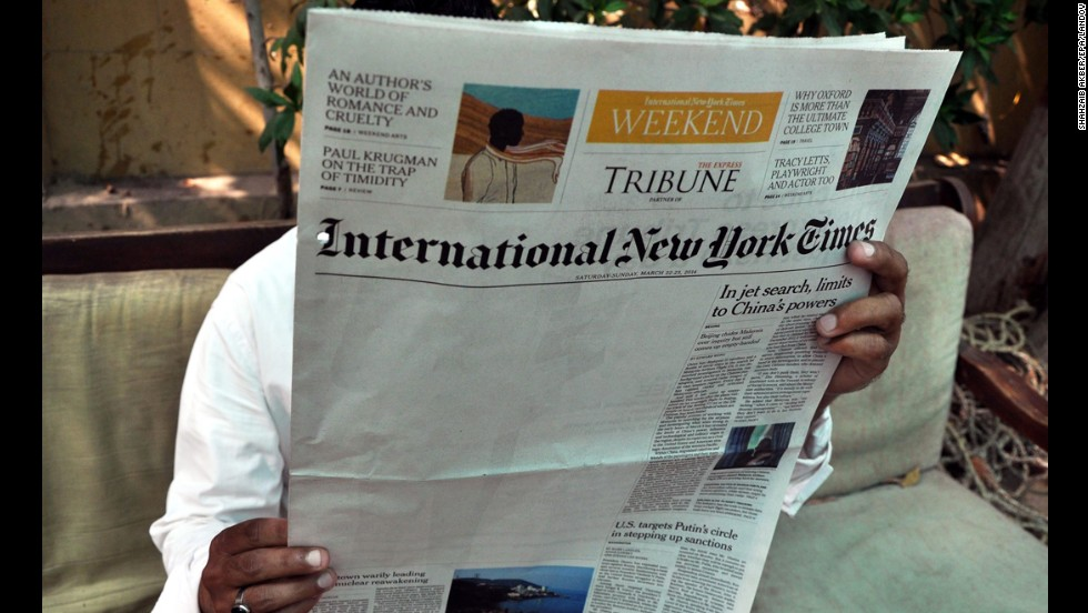 "A man reads a copy of the International New York Times at an office in Karachi, Pakistan, on Monday, March 24. <a href=""http://www.nytimes.com/2014/03/23/business/media/times-report-on-al-qaeda-is-censored-in-pakistan.html"" target=""_blank"">The New York Times says</a> an article about Pakistan's relationship to al Qaeda was censored by its local distributor in the country, leaving a blank space on its weekend edition."