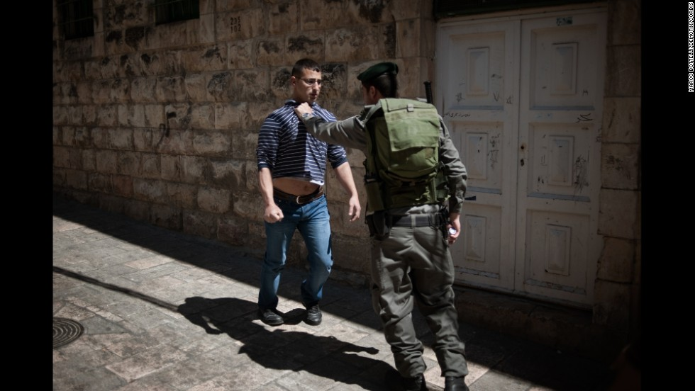 An Israeli soldier stops a young Muslim in front of the Al-Aqsa Mosque in Jerusalem on Friday, March 21.