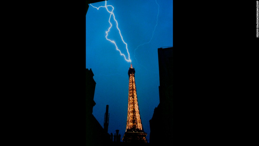 A lightning bolt strikes the top of the Eiffel Tower during a thunderstorm in 1992.