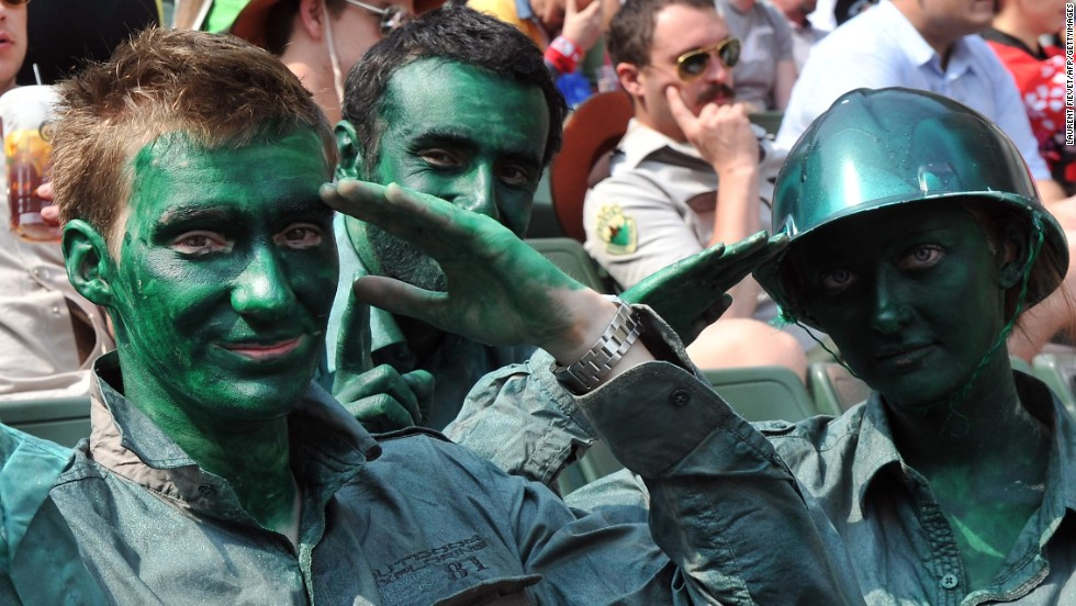 <strong>Three</strong> saluting soldiers...