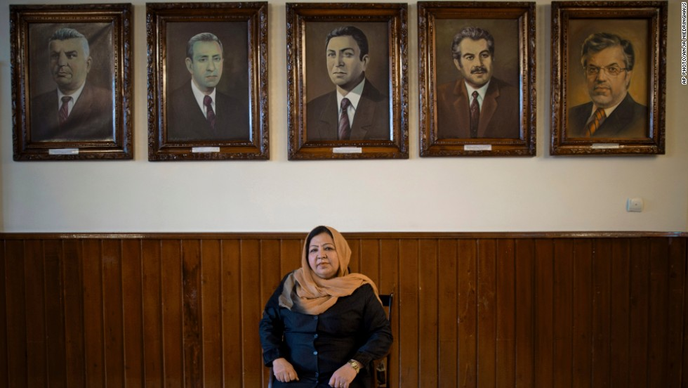 MARCH 28 - KABUL, AFGHANISTAN: Afghan lawmaker Habiba Sadat from Helmand province poses under pictures of former presidents of Afghanistan's parliament. During the Taliban rule, women rarely left their homes. In this year's presidential election, three leading candidates have chosen women as their running mates.