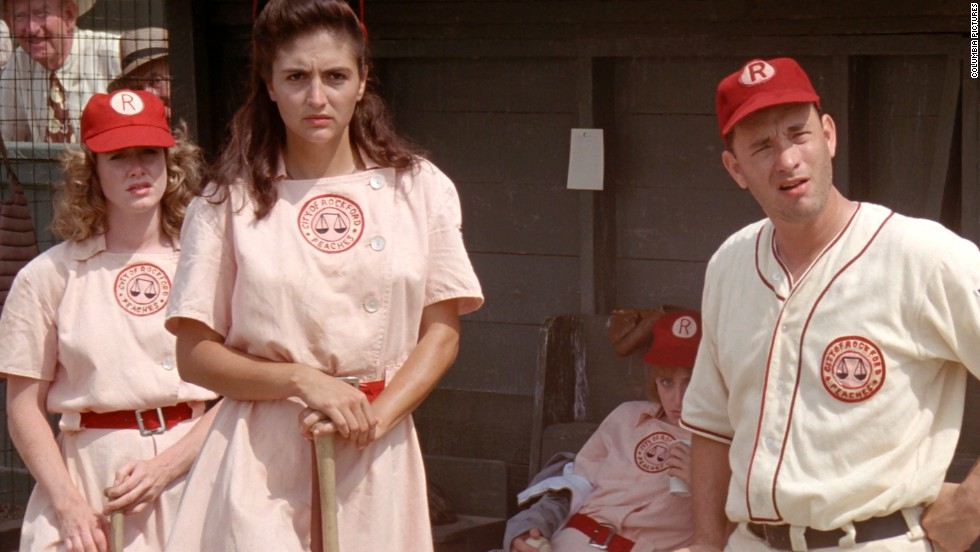 """Tom Hanks, right, plays the coach of a team in the women's professional baseball league in the 1992 film """"A League of Their Own."""""""