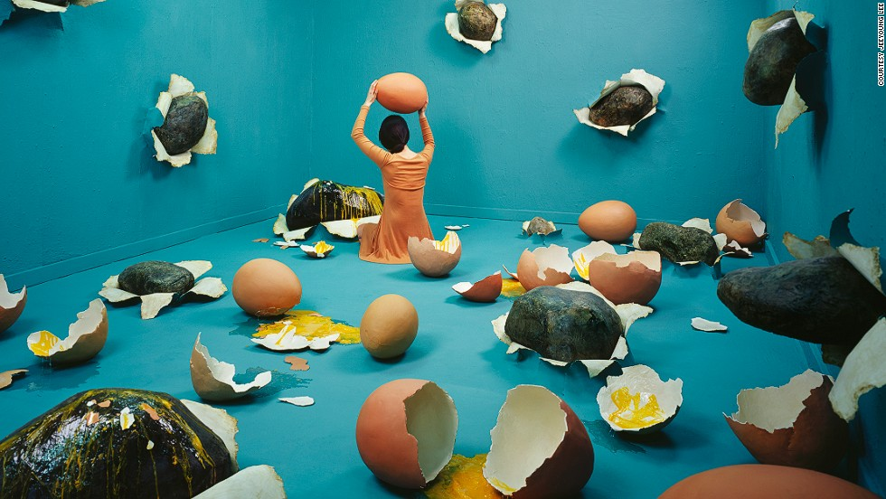 """<em>Broken heart </em><br /><br />Korean proverb """"to hit a rock with an egg"""" served as the basis behind this image depicting Lee's heartache: """"Eggs are so fragile and easy to break, so I felt they would be a poignant contrast to the firmness of the rocks,"""" she says. <br /><br />Like in all her photos, Lee's gaze is fixed away from the camera, and she acts merely as a prop in a larger narrative: """"If the character looked straight ahead, it would make it hard for the audience to inflict their own emotions on the image,"""" she explains."""