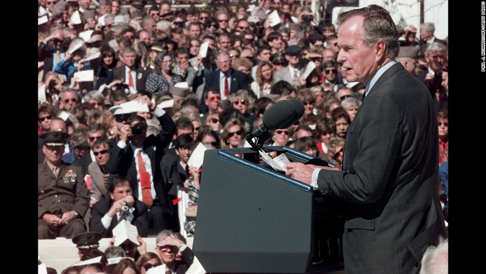 In November 1997, Bush speaks at the dedication of his presidential library at Texas A&M University.