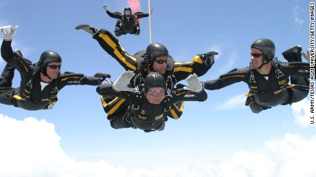 COLLEGE STATION, TX - JUNE 13:  Former U.S. President George H.W. Bush (C, bottom) performs a tandem parachute jump with Army Golden Knight Sgt. Bryan Schnell on June 13, 2004 over the Bush Presidential Library in College Station, Texas. (Photo by U.S. Army/Texas A&M University via Getty Images)