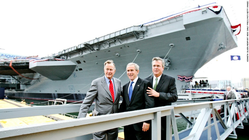 At the christening ceremony of the USS George H.W. Bush in 2009, the 41st President poses for a picture with two of his sons: former President George W. Bush and former Florida Gov. Jeb Bush.