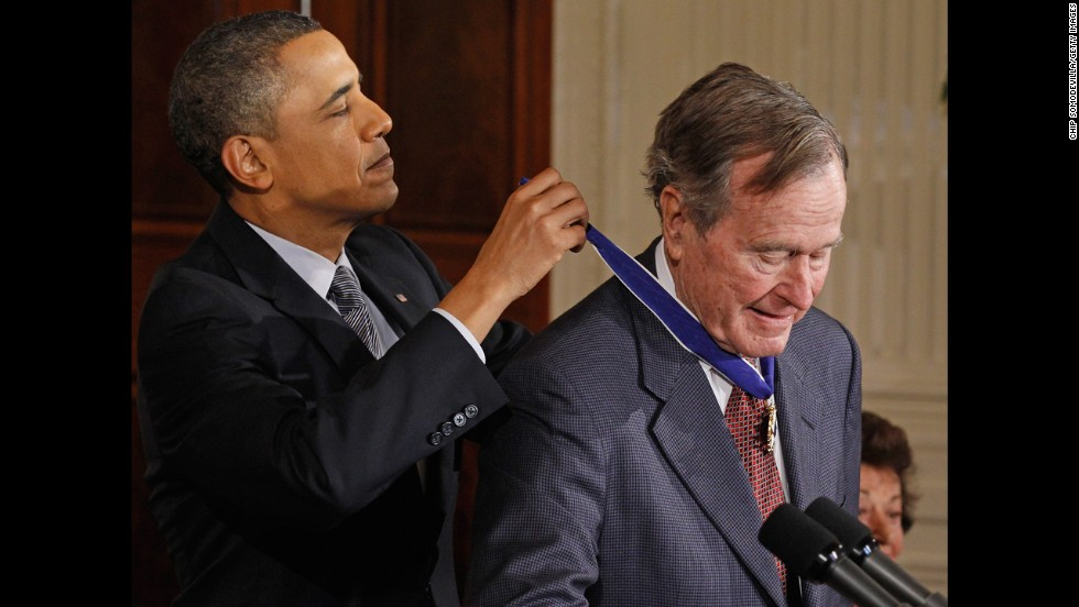 President Barack Obama presents Bush with the 2010 Medal of Freedom at the White House in February 2011.