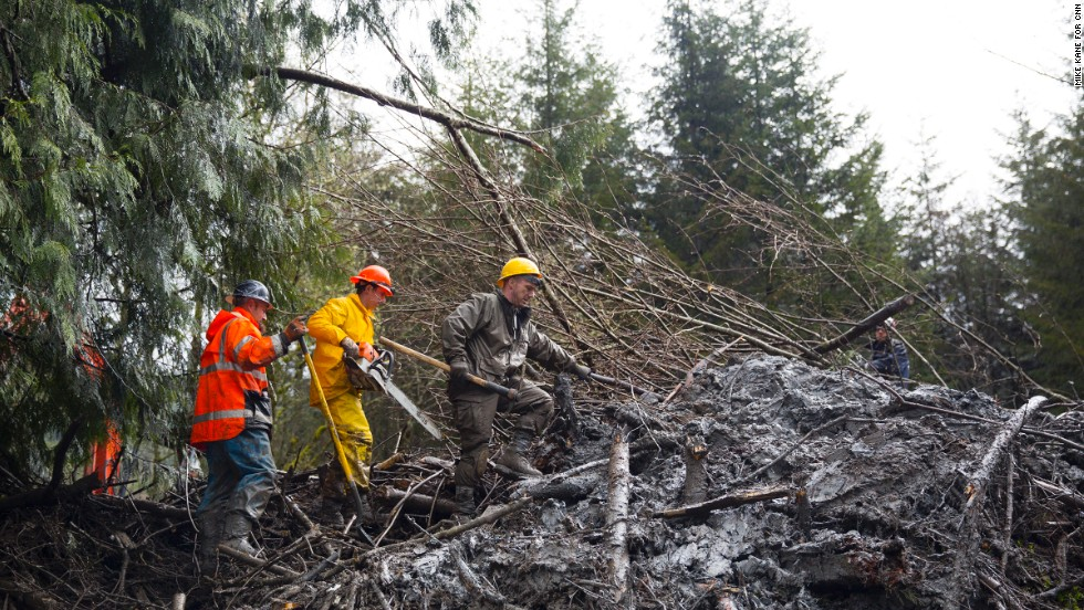 Rescue workers comb through mud and debris on Saturday.