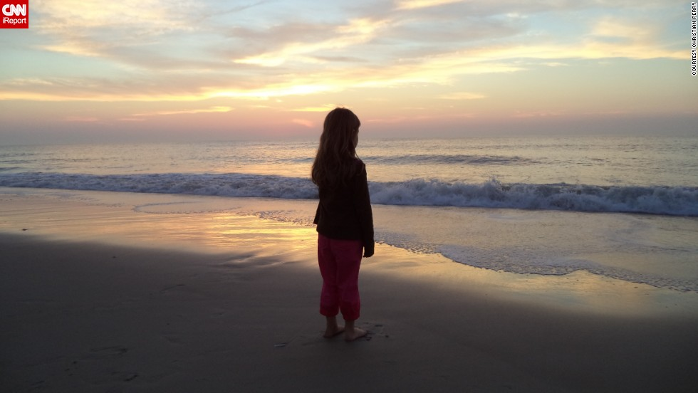 """<a href=""""http://ireport.cnn.com/docs/DOC-1082670"""">Christian Perry</a> drove all through the night with his 5-year-old daughter, Catherine, for her first trip to the ocean. They went to the same beach in Ocean City, Maryland, that his dad took him to when he was a kid. """"I hadn't been to the beach since before she was born because I wanted to wait until she was old enough to share in the experience with me,"""" he said. """"Watching her stare at the big blue sea allowed me to see the ocean through her eyes, and that was a moment as a father that I will never forget."""" Perry's iReport inspired this story."""