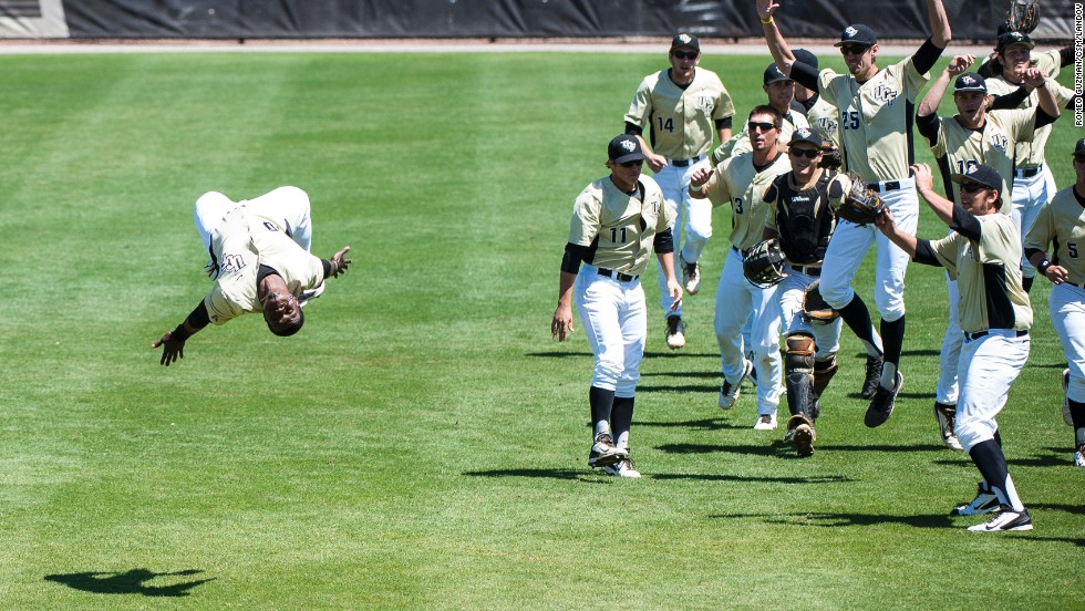 Erik Barber, an outfielder for the University of Central Florida, does a pregame flip as he leads his team to the dugout Sunday, March 30, in Orlando.
