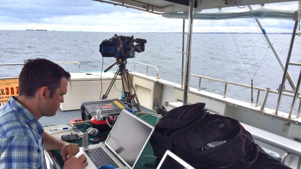 CNN senior producer David Molko prepares for one of dozens of live shots from the aft deck of the Thunder.