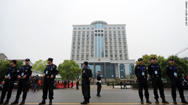 Police stand guard outside the Xianning Intermediate People's Court, where mining tycoon Liu Han stands trial for charges including murder.